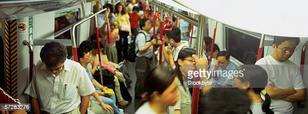 People traveling in a subway train in Hong Kong