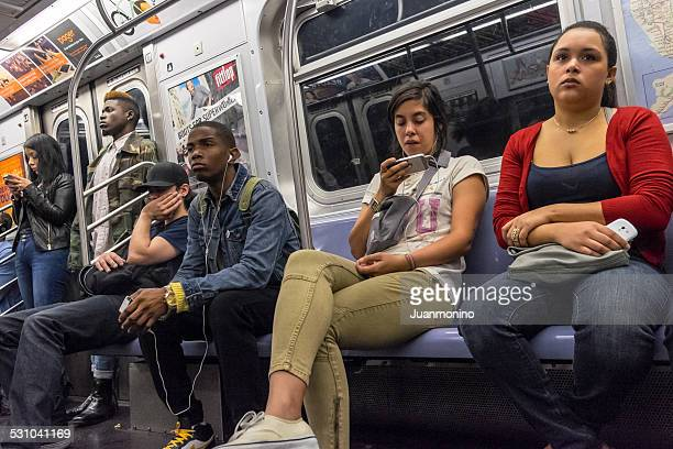 People traveling in a subway train in New York city