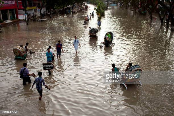 AGRABAD DHAKA CHITTAGONG BANGLADESH People traveling in flooded areas in Chittagong Chittagong city is facing unprecedented flooding this year due to...