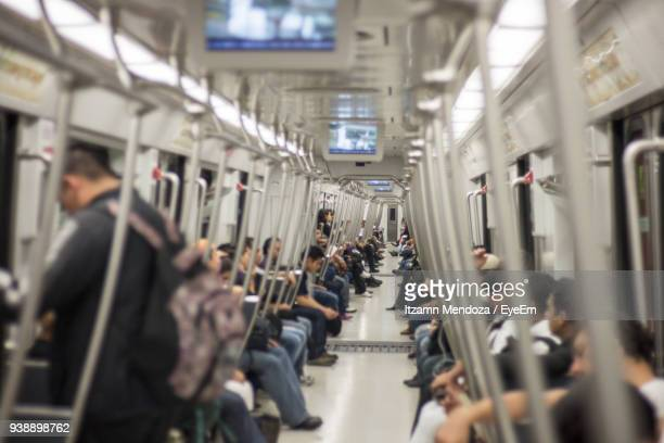 people traveling in train - subway train stock pictures, royalty-free photos & images