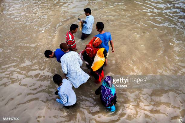 AGRABAD DHAKA CHITTAGONG BANGLADESH People traveling through a flooded area of Chittagong People traveling in flooded areas in Chittagong Chittagong...