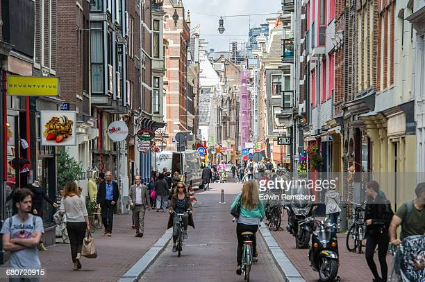People traveling through a street in Amsterdam