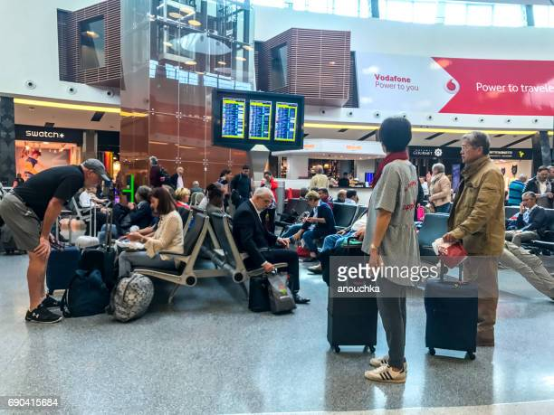 people traveling through lisbon portela airport, portugal - atlantic islands stock pictures, royalty-free photos & images