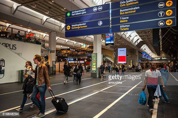 People traveling through Oslo Central Train Station