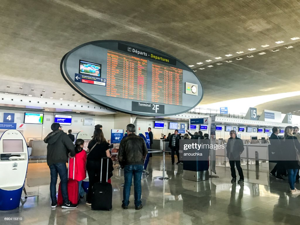 People traveling through Roissy Charles de Gaulle Airport, Paris, France : Stock Photo