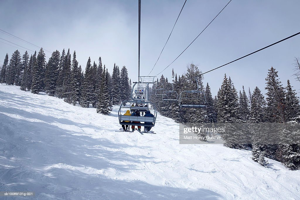 People travelling in cable car, rear view : Stockfoto