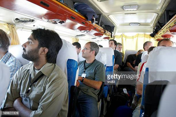 People travelling on a coach