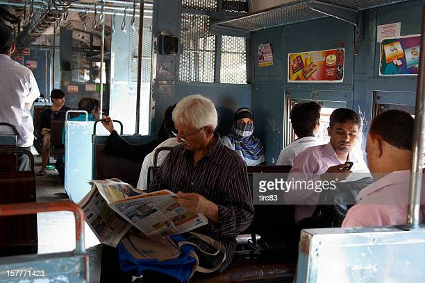 People travelling on local Mumbai train