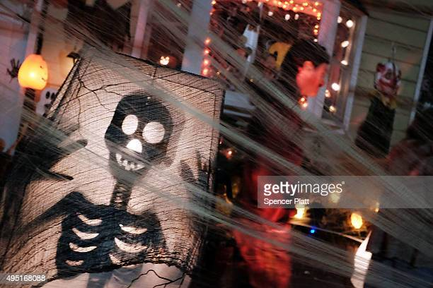 People trick-or-treat in a Brooklyn neighborhood on Halloween night on October 31, 2015 in New York City. Throughout the country children and adults...