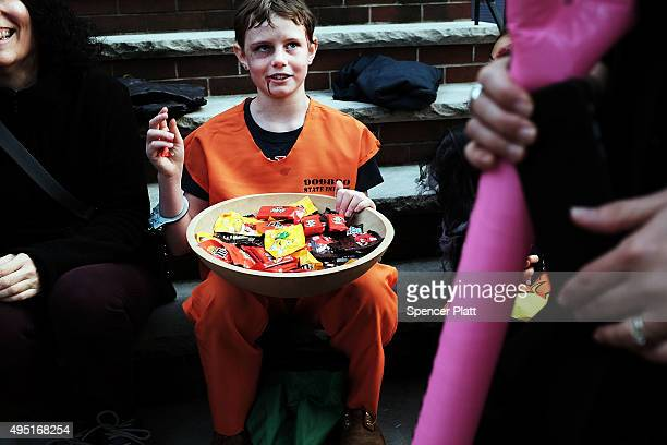 People trickortreat in a Brooklyn neighborhood on Halloween night on October 31 2015 in New York City Throughout the country children and adults are...