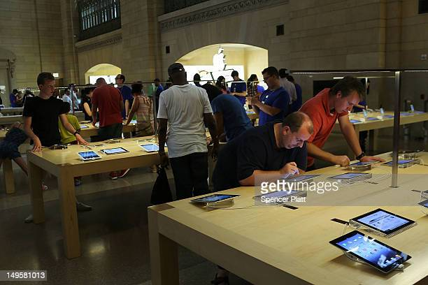 People try Apple products at the Apple store in Grand Central Terminal on July 31 2012 in New York City According to a new audit by New York State...