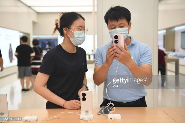 People try Huawei P50 smartphone at a Huawei flagship store on July 30, 2021 in Shanghai, China.