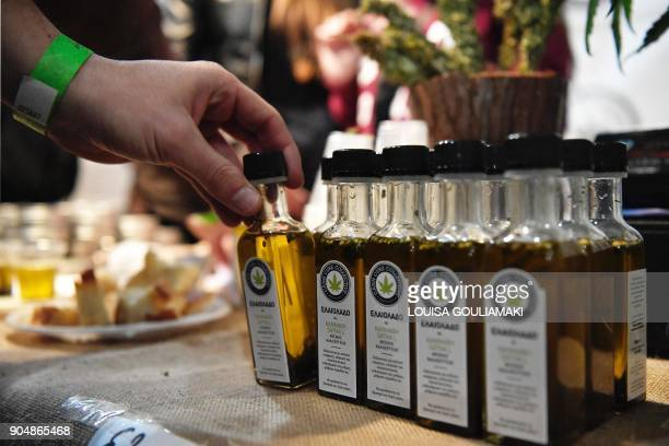 People try olive oil with cannabis during the first Athens Cannabis Expo in the southern Athens suburb on January 14 2018 Greece's parliament is...