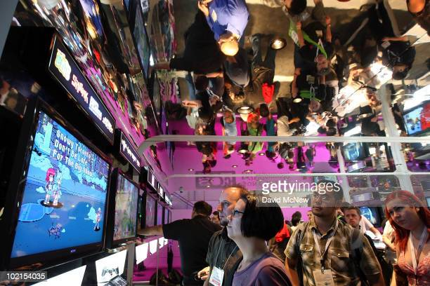 People try out games in the Sony Playstation 2 exhibit in the annual Electronic Entertainment Expo at the Los Angeles Convention Center on June 16,...