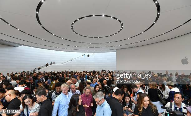 People try out new Apple products during a media event at Apple's new headquarters in Cupertino California on September 12 2017 / AFP PHOTO / Josh...