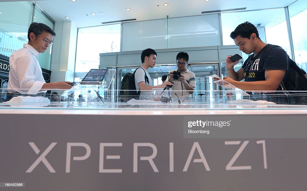 People try out Sony Corp. Xperia Z1 smartphones at one of the company's showrooms in Tokyo, Japan, on Friday, Sept. 13, 2013. Sony Corp. is betting its Xperia Z1 handset will propel it to No. 3 in the smartphone market, leaping from seventh place by vaulting past competitors such as LG Electronics Inc. and Lenovo Group Ltd. Photographer: Yuriko Nakao/Bloomberg via Getty Images