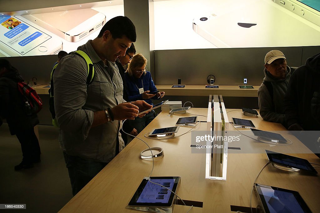 People try the new Apple iPad Air at the Apple Store on November 1, 2013 in New York City. The new iPad, the fifth generation of the popular tablet, is 20% thinner and 28% lighter than the current fourth-generation iPad. It has the same 9.7-inch screen as previous iPads and uses the same A7 processing chip that's in the iPhone 5S. The iPad Air, which went on sale today, will start at $499 for a 16GB Wi-Fi-only model and go up to $629 for a 16GB with 4G LTE connectivity.