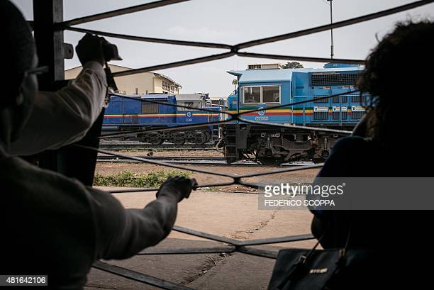 People try to access the tracks at the Brazzaville train station on July 22 in Brazzaville Tickets must be purchased one week before the departure...