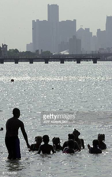People try to beat the heat by swiming in the Detroit River off of Belle Isle in Detroit 09 August 2001. Temperatures have been unseasonably hot with...