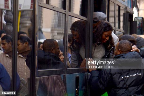 People try to enter in crowded bus at a public transport station on January 31 2017 at Piazza Venezia in Rome Public transport system has a bad...