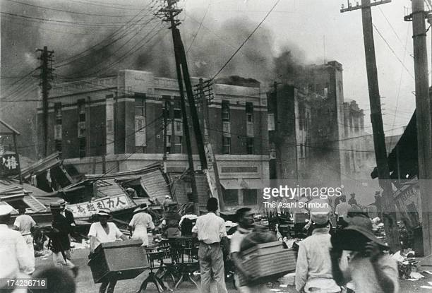 People try to evacuate from the massive fire following the Great Kanto Earthquake on September 1 1923 in Tokyo Japan The estimated Magnitude 79...