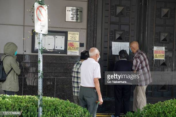 People try to gain access to the Chinese consulate after the United States ordered China to close its doors on July 22, 2020 in Houston, Texas....