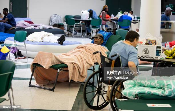 People try to get some rest at Lincoln High School as Hurricane Michael approaches on October 10 2018 in Tallahassee Florida The hurricane is...
