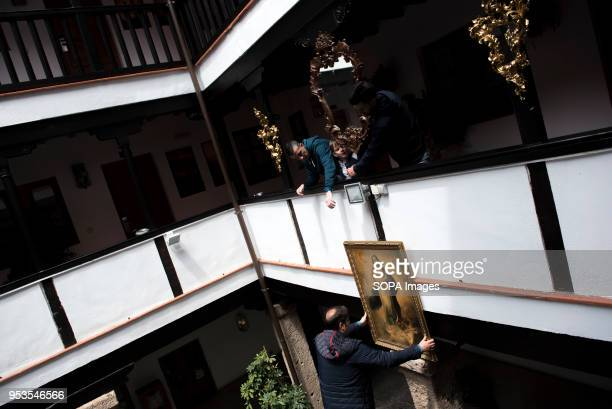 People try to hang a picture in the 'Corrala de Santiago' for the preparations of the upcoming 'Dia de la Cruz' in Granada El día de la Cruz or Día...