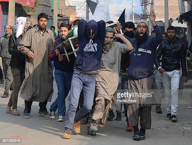People try to protect the dead body of 16 year old boy Kaiser Ahmad after Indian police resorted to heavy teargas shelling in Srinagar the summer...