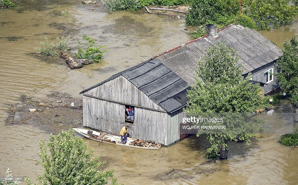 People try to rescue their goods from flooded houses at Swiniary village in central Poland at Wisla river on May 25, 2010. Torrential rain in Poland's mountainous south have caused rivers, including the Vistula, Poland's largest, swell to levels unseen in more than a century.