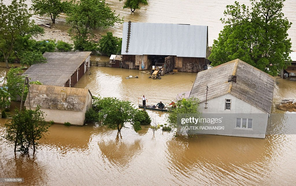 People try to rescue their goods from their flooded houses in the area of Swiniary village in central Poland, at Wisla river. on May 25, 2010. Floods caused by torrential rains last week have swollen major Polish rivers to their highest levels in more than a century and have claimed 15 lives.