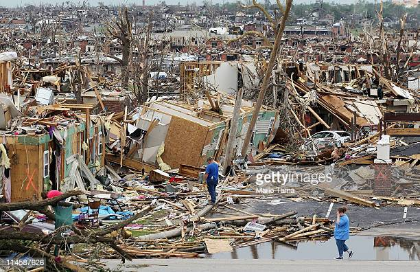People try to salvage items from homes destroyed when a massive tornado passed through the town killing at least 116 people May 24, 2011 in Joplin,...