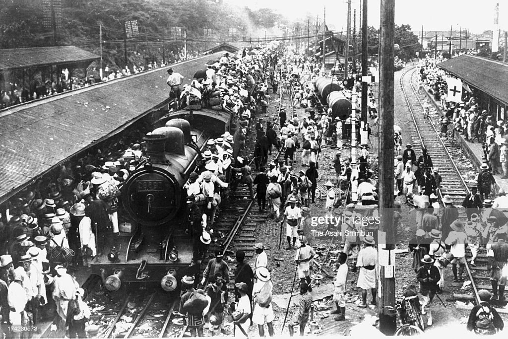 People trying to evacuate from Tokyo gather at Nippori Station after the Great Kanto Earthquake on September 9, 1923 in Tokyo, Japan. The estimated Magnitude 7.9 strong earthquake hit Japan's capital Tokyo and surrounding area, the death toll was estimated up to 105,000 people. Approximately 38,000 victims were killed by fire whirl engulfed the former Army Clothing Depot site, where people had evacuated.