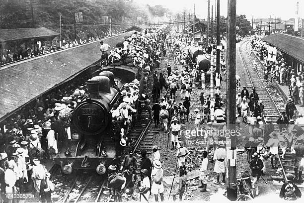 People trying to evacuate from Tokyo gather at Nippori Station after the Great Kanto Earthquake on September 9 1923 in Tokyo Japan The estimated...
