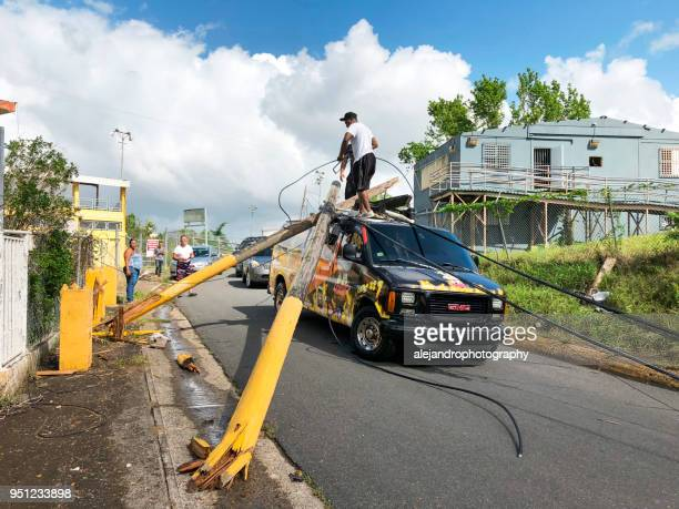 people trying to remove power poles off van - 2017 hurricane maria stock pictures, royalty-free photos & images