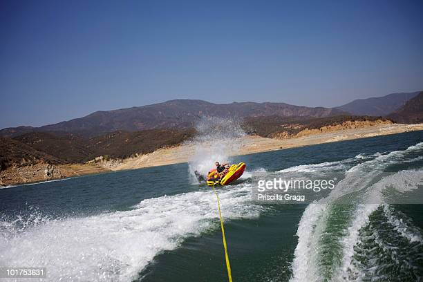 people tubing in castaic lake, santa clarita, california are about to flip over. - santa clarita stock pictures, royalty-free photos & images