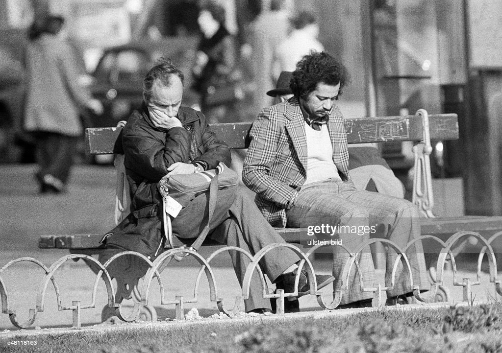 people, two men sit side by side on a bench, both are very depressed and tearily, aged 25 to 30 years, aged 30 to 40 years, France, Paris - 09.02.1975 : News Photo