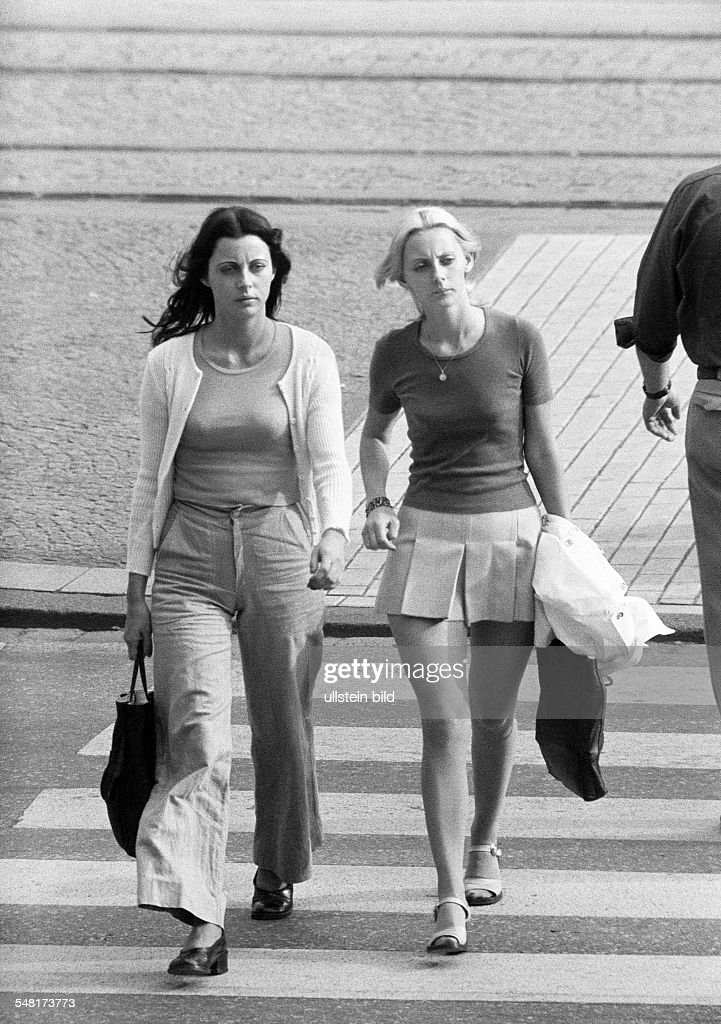people, two young girls on shopping expedition, shopping bags, pulli, miniskirt, trousers, waistcoat, zebra crossing, aged 20 to 25 years - 31.08.1973 : News Photo