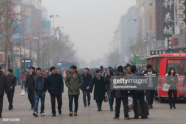 people under a heavy pollution day in beijing - chinese mask stock photos and pictures