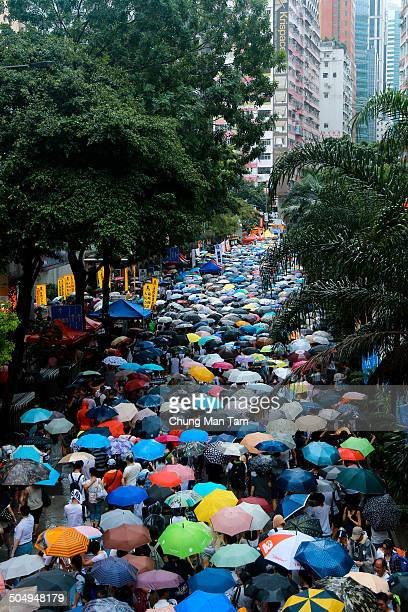 People under umbrellas fill in a street during a rally seeking greater democracy in Hong Kong.