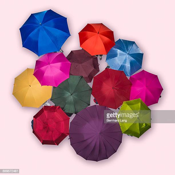 People underneath colored umbrellas, Aerial View