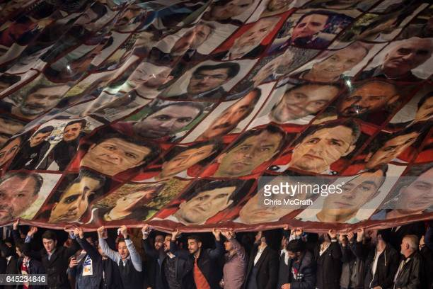 People unfurl a large banner showing the faces of people killed during the July 15 failed coup at a rally officially opening the AKP Party 'Yes'...