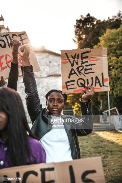 people united against racism. anti-racism protest - racism stock pictures, royalty-free photos & images
