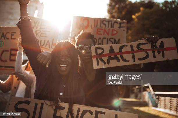 people united against racism. anti-racism protest - social movement stock pictures, royalty-free photos & images