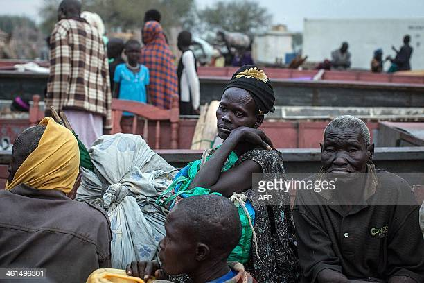 People unload the few belongings on January 9 2014 at Minkammen South Sudan that they were able to bring with them to the camps Hundreds of civilians...