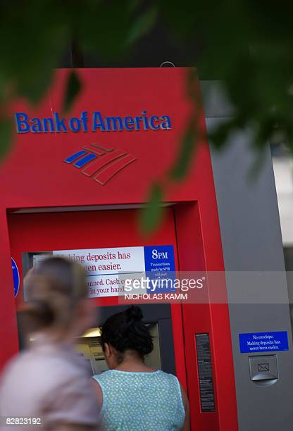 People use a Bank of America automatic teller machine in Washington on September 15 2008 Bank of America announced earlier in the day it was buying...