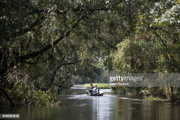 People use a boat and four wheeler to navigate flood waters caused by Hurricane Irma Sept 12 2017 near Palatka Florida United States The storm...
