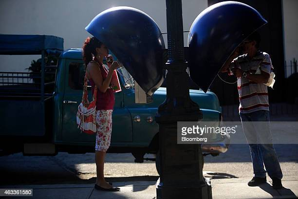 People use a public phone in Santiago de Cuba Cuba on Sunday Jan 18 2015 US companies will be permitted to export to Cuba telecommunications...