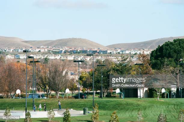 People use a skatepark at Emerald Glen park with new housing visible in the background a public park in the rapidlydeveloping San Francisco Bay Area...