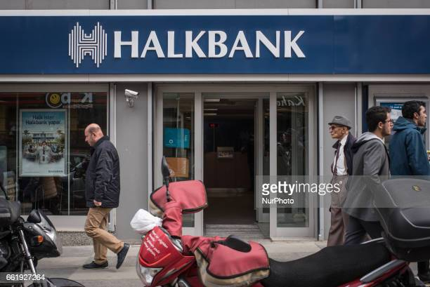 People use an ATM to withdraw money at a branch office of Halkbank BranchTurkish staterun bank Halkbank had its deputy general manager Mehmet Hakan...